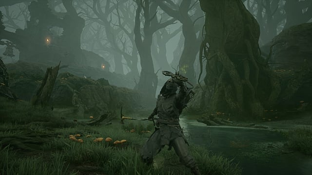 Tiel, the Acolyte in thief's armor holding an axe behind him and a talisman in front of his face in a misty swamp.