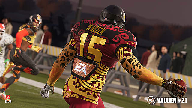A custom player in cheetah sleeves, red and gold jersey stares at receiver, ready to throw.