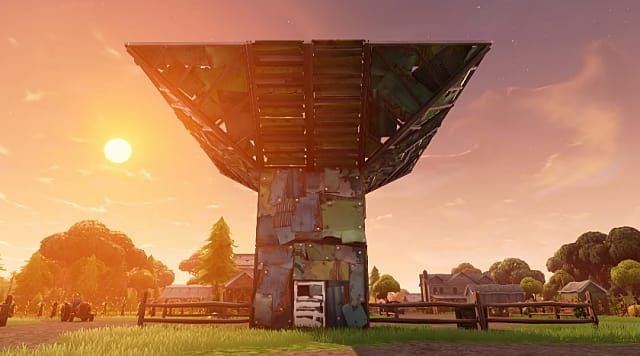 a fortification in Fortnite in front of a setting sun