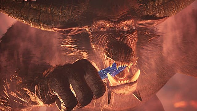 Rajang eats a bluish silver something in Monster Hunter: World Iceborne.