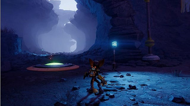 Ratchet standing in a foggy cave, looking at a gold bolt hovering on a small platform.