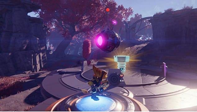 Ratchet standing beneath a round, floating robot near a gold bolt.