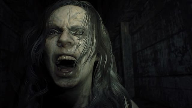A terrifying screenshot of a woman screaming in Resident Evil 7 on PSVR