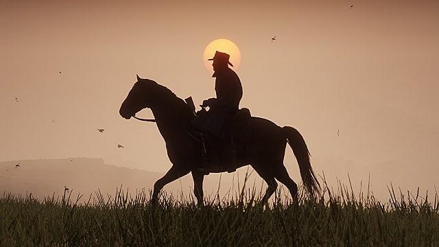 red-dead-marston-horseback-against-sunset-94e16.jpg