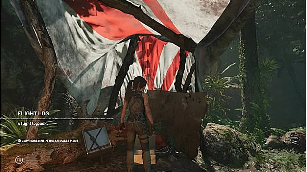 Lara finds the first relic under an open red and white parachute near basecamp