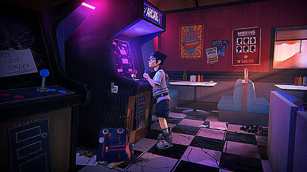 Kid wearing glasses playing an arcade cabinet in neon light.