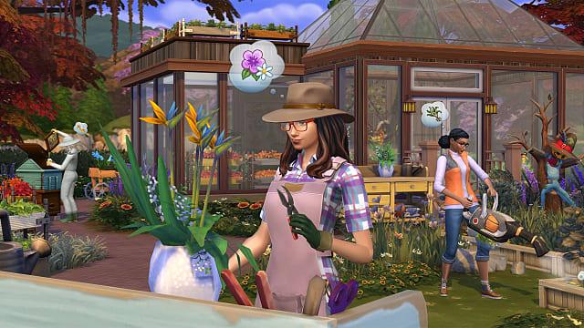 Botanist wearing a brown hat while gardening.