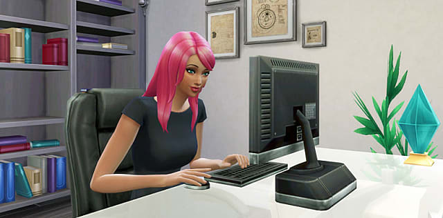 Sim with pink hair sitting in front of a monitor.
