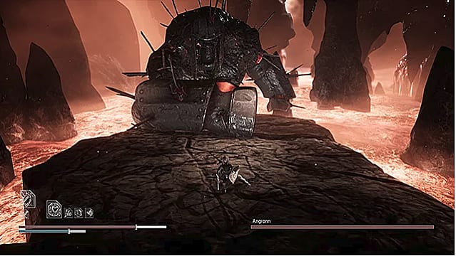 The massive Angronn slams his armor covered fist on the rocky stage surrounded by lava