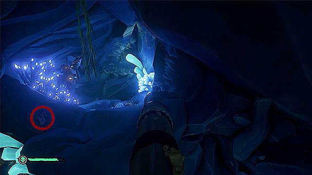A lever to the left of a fallen mast by some blue, glowing flora.