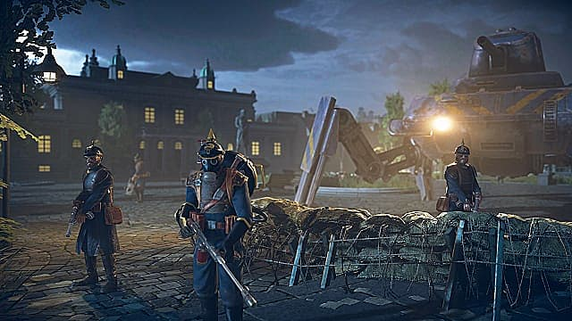Three Saxony soldiers in blue and a spider-tank guard a barbedwire barricade in a city at night.