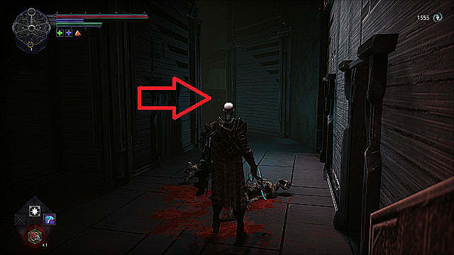 The player character standing in a tight hallway with two dead, bloody enemies lying on the ground.