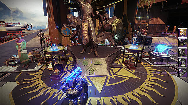 A Warlock kneels in front of a gold Hunter, Warlock, Titan statue at the Tower as Eva Levante watches.
