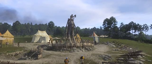 The finished trebuchet surrounded by tents in the military camp.