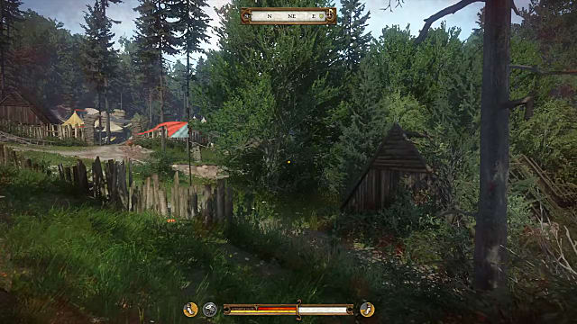 Player sits outside the bandit camp looking through the trees at a red tent