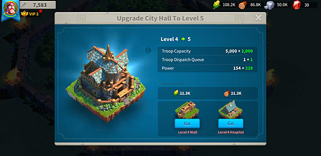 Upgrading the town hall, showing the hall's level, troop capacity, and power, as well as upgrades