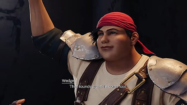 Wedge, wearing a red bandana, holding arm up in victory.