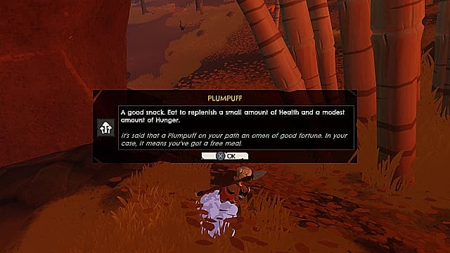 Kara, holding a spear, picks up a plumpuff mushroom on brown grass, with a menu describing the item in Windbound.