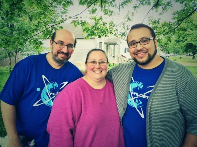 Community Manager Tony Reyes with Jennifer Baugh and her husband John.