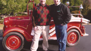 Dan Banks and our Hector Cademartori next to his 1939 Datsun fire truck, red of course.