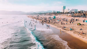 a Los Angeles beach with loads of people enjoying the sun and ocean.