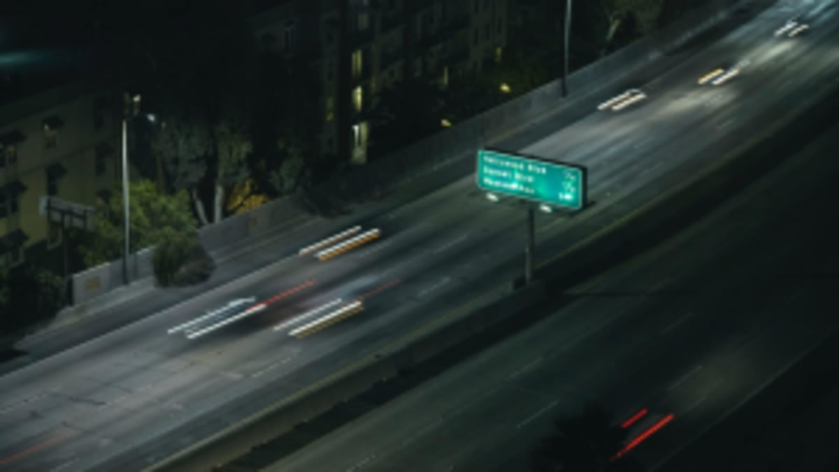 blurry cars on a Los Angeles freeway