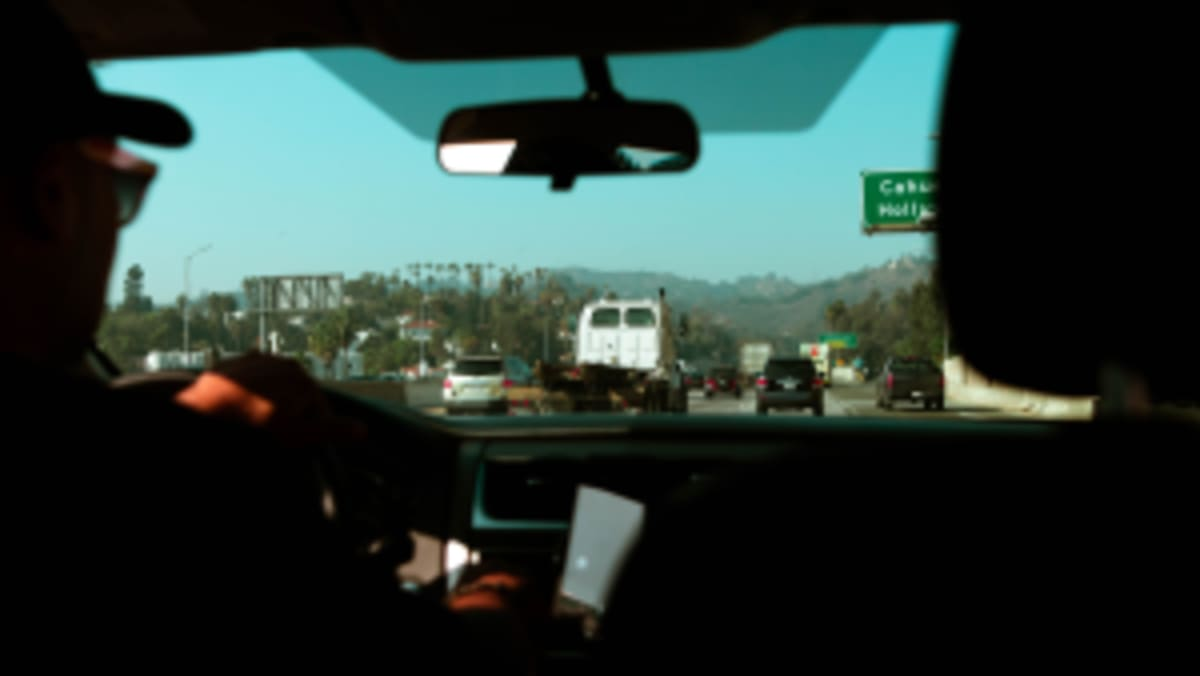 looking out through the windshield of a car on a Los Angeles freeway