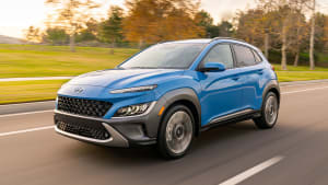 Blue 2022 Hyundai Kona driving on road