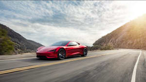 A red Tesla Roadster - now on display at Petersen Automotive Museum -cruising in the mountains surrounding Los Angeles.