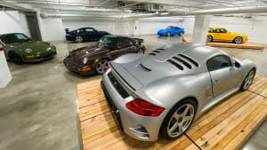 a silver RUF Porsche on the exhibition floor of The Petersen Museum in Los Angeles.