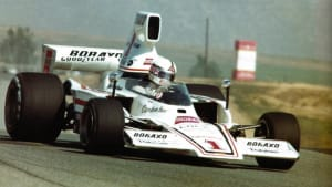 white Formula 5000 race car on the track