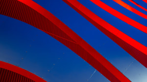 an artsy close-up photo of the exterior of The Petersen Museum with red and blue lines.