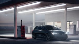 2021 Toyota Corolla Hatchback parked at a dim-lit gas station.