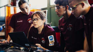 Harbor Freight Tools For Schools 2017 winner Roxanne Amiot sitting by computer with her students