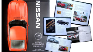 """the front cover of the book """"Nissan Z - 50 Years of Exhilarating Performance"""" with a top-down image of an orange Datsun Z on a black background."""