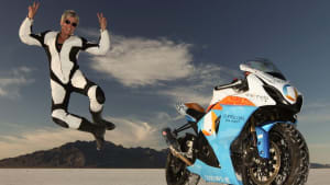 Motorcycle racer Erin Sills, 56, mid-air next to her motorcycle, jumping of joy after setting yet another land speed record.