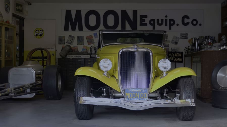 Yellow Dean Moon Roadster standing in garage