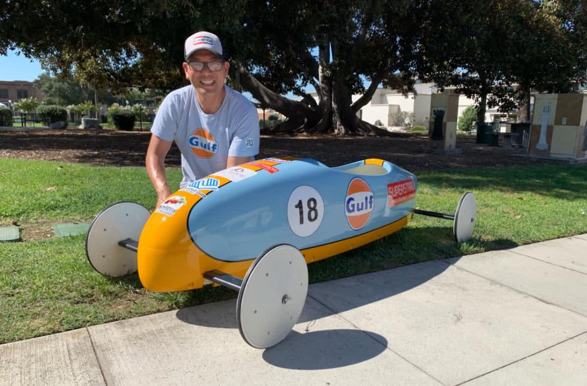 LA Car's Glenn Oyoung next to his Ferrari Brothers Body Shop-prepared Gulf Racing soap box car for the 2019 Monrovia Old Town Derby. Photo by Roy Nakano