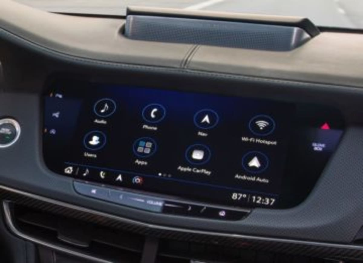 The glove box button is just right of the infotainment screen, and the volume slider is below.