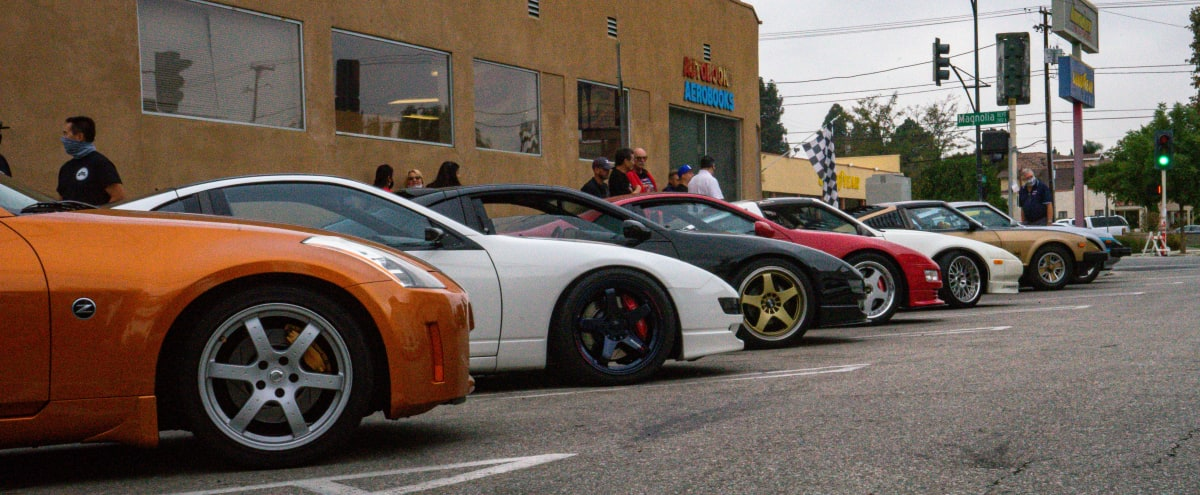 A group of 280s, 300s, 300Zx and a 350 with Autobooks bookstore as the backdrop.