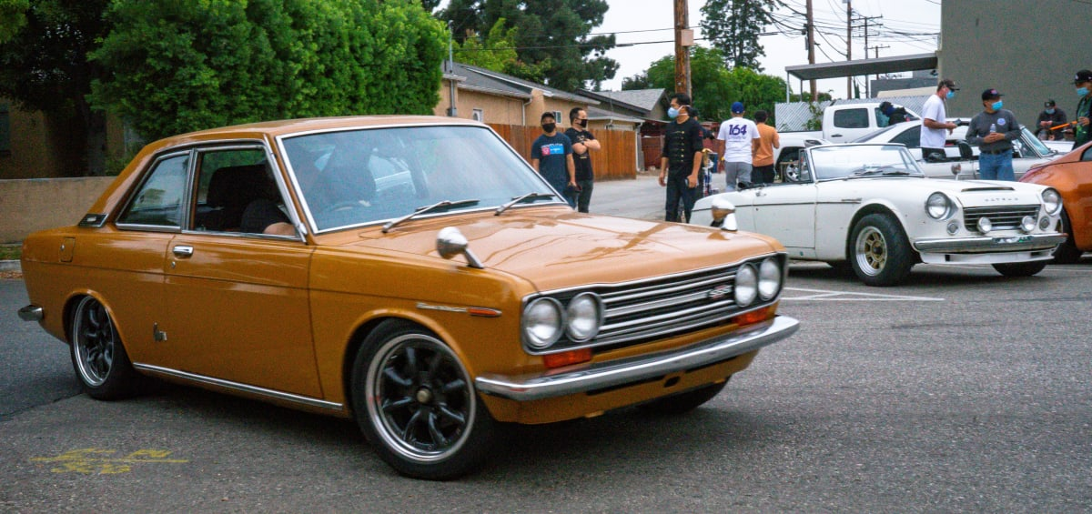 "Not only Zs, but also other members of the Datsun family answered the call. In the photo a 510 Coupe, also known as ""Bluebird"", and a Roadster."