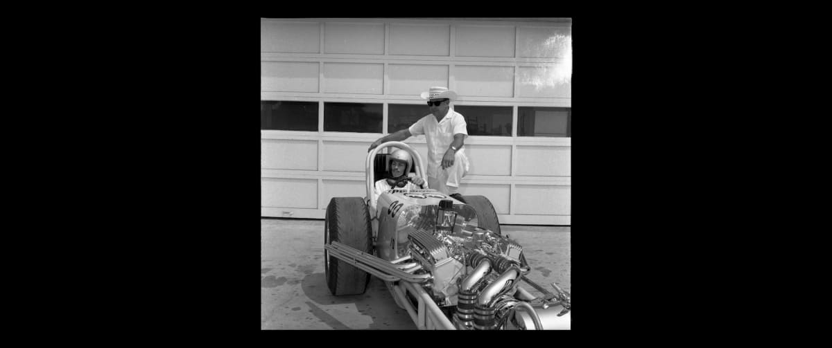 Dean Moon, the Founder of Mooneyes, and driver Dante Deuce sitting in Dean's dragster.