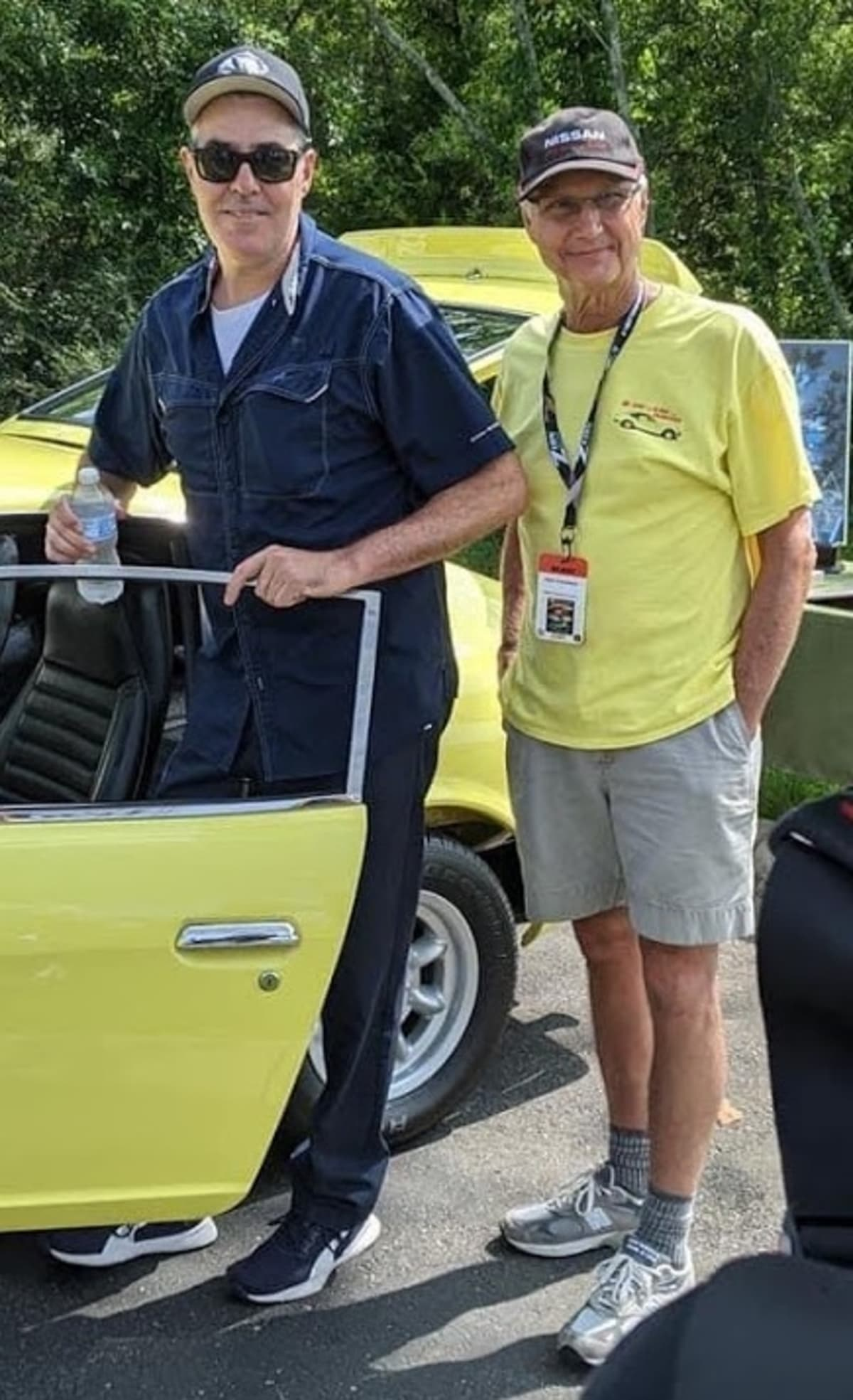 Datsun racer and collector Adam Carolla attended the event and helped with the judging. In the photo with his bodyguard.