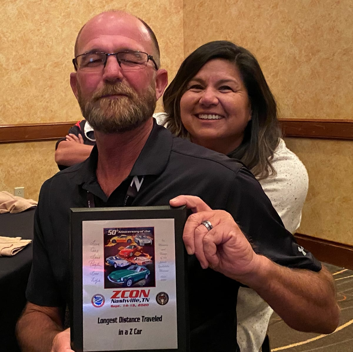 David and Angie Bailey with their trophy for Longest Distance Traveled in a Z to the Show- over 2400 miles from Southern California. Congratulations!