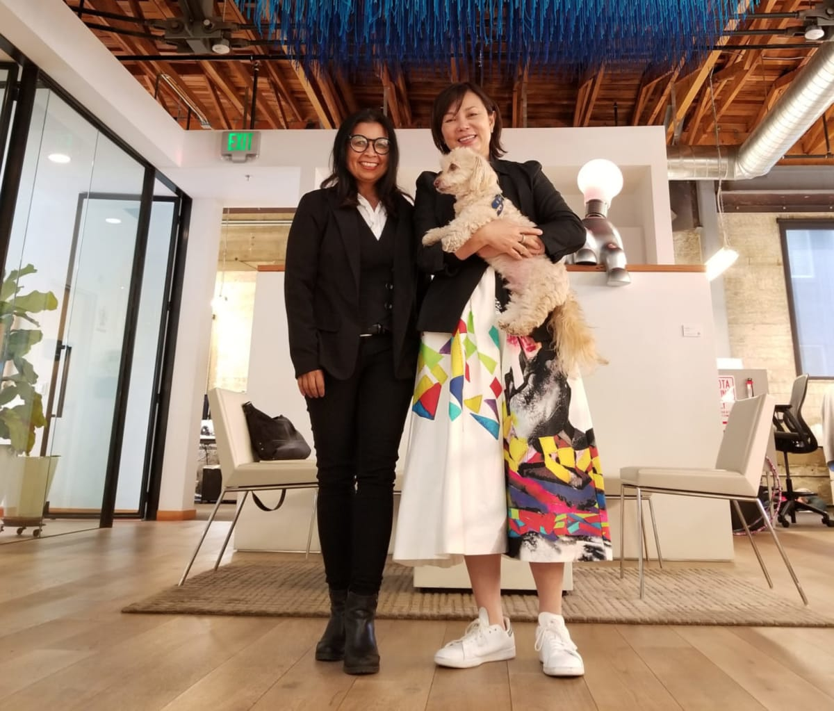 LA Car's Ami Pascual Spear with interTrend's Julia Huang and the interTrend company canine, Renzei