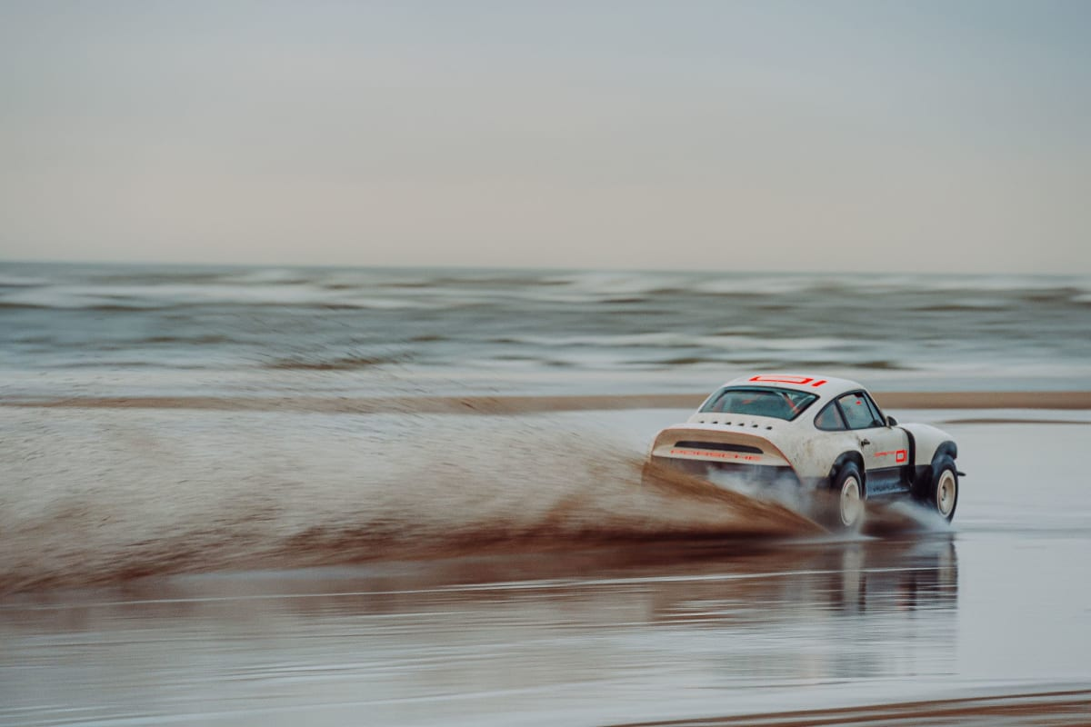 All-terrain Competition Study in Parallax White, Singer's first restoration developed to a client's motorsport specification shown at speed on sand.