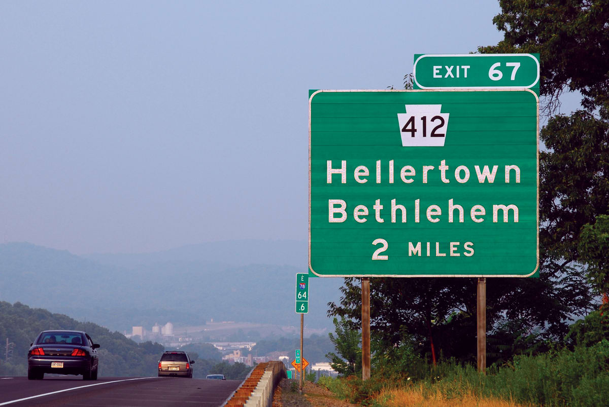 """highway sign for the Hellertown exit off the 412 highway, with """"Highway Gothic"""" font."""