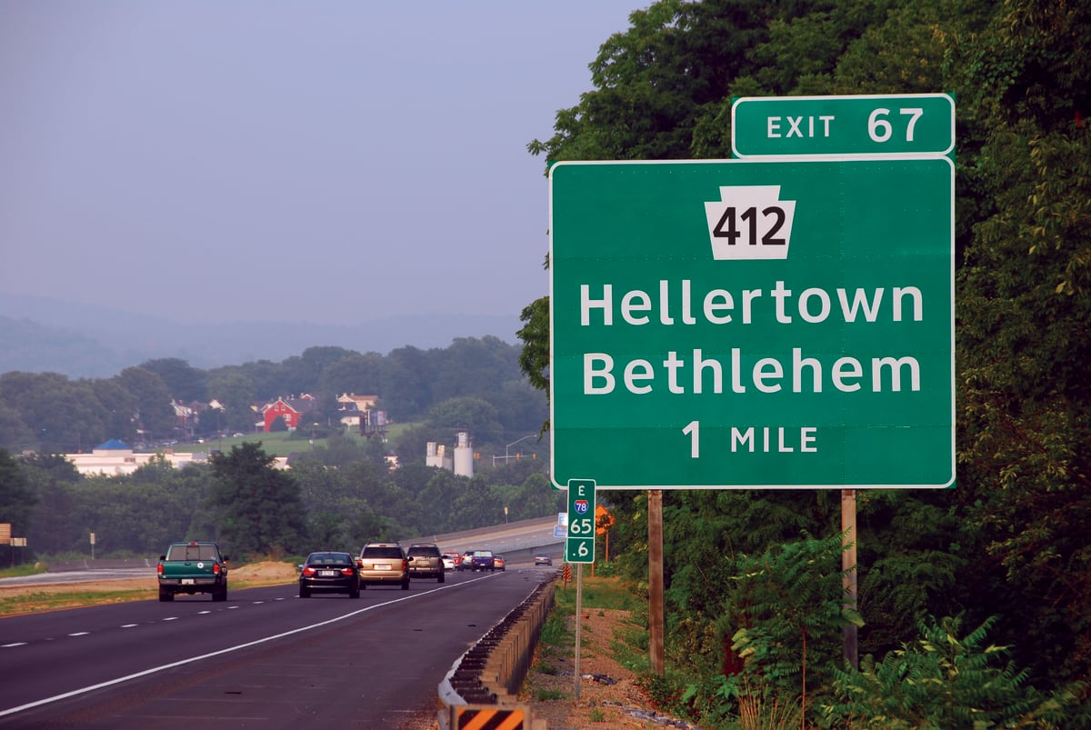 """highway sign for the Hellertown exit off the 412 highway, with """"Clearview"""" font."""