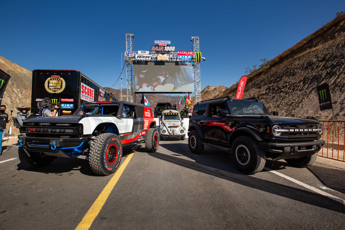 The Ford Bronco R race prototype and a 2021 Bronco Outer Banks™ two-door preproduction support vehicle.