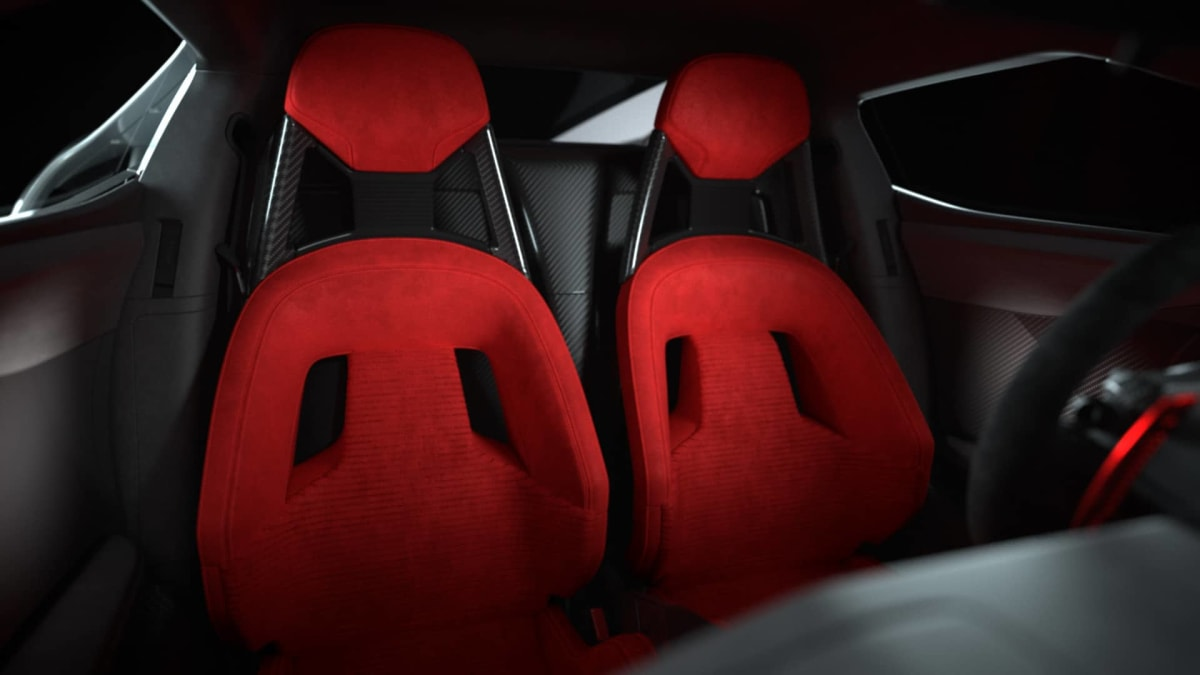 The interior sports red Alcantara suede performance seats.